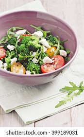 Broccoli salad with tomatoes,arugula and feta cheese.Selective focus