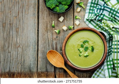 broccoli soup puree on a dark wood background. tinting. selective focus