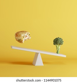 broccoli vegetable tipping seesaw with floating berger on opposite end on yellow background. food idea minimal.
