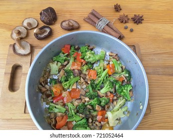Broccoli and vegetables with mushrooms shiitake cooking healthy vegetarian food