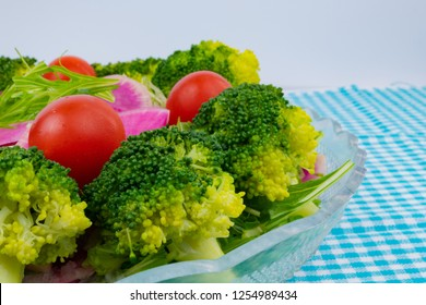 Broccoli and watermelon radish and mizuna salad