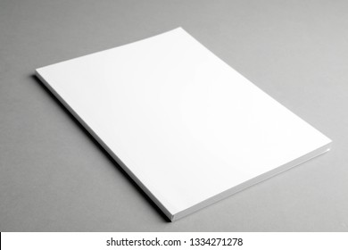 Brochure with blank cover on grey background. Mock up for design