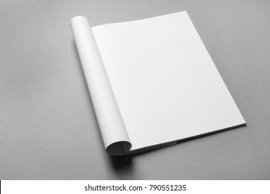 Brochure with blank pages on grey background. Mock up for design