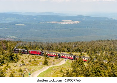 Brocken Germany - May 27. 2017: Steam train climbing the tracks towards the top of Brocken Mountain