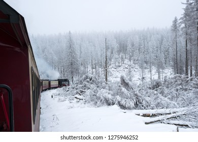 BROCKEN, HARZ, GERMANY - DECEMBER 17, 2018: Steam engined narrow gauge train at the Brocken Bahn in National Park Harz in Germany during winter