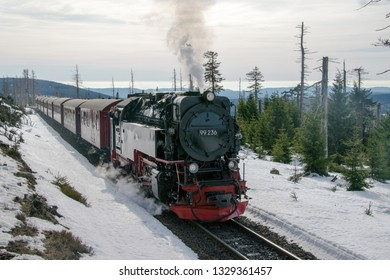 BROCKEN, HARZ, GERMANY - FEBRUARY 23, 2019: Steam engined narrow gauge train at the Brocken Bahn in National Park Harz in Germany during winter