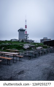 Brocken hotel with antenna and benches in the foreground