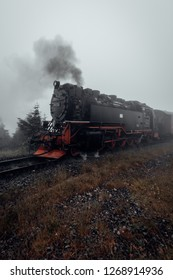 The Brocken railway runs through the Harz mountains in cloudy weather