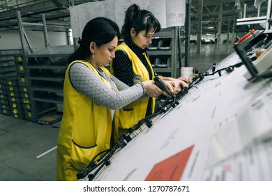 Brody, Lviv / Ukraine - December 13 2017: Female production workers in the new factory for producing cable networks for automobiles