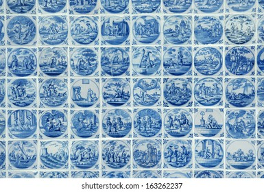 BROEK IN WATERLAND, THE NETHERLANDS - SEPTEMBER 21. A tableau of antique Delft blue tiles depicting a variety of different scenes. September 21, 2011. Broek in Waterland, The Netherlands.