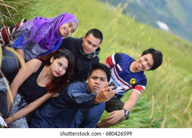 Broga Hill, Semenyih Negeri Sembilan, MALAYSIA - 22 August 2015. A bunch of people hiking and doing an outdoor activity at Broga Hill, Semenyih Negeri Sembilan, Malaysia.