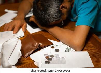 Broke desperate man with bank bills and bad debt. Financial money crisis.