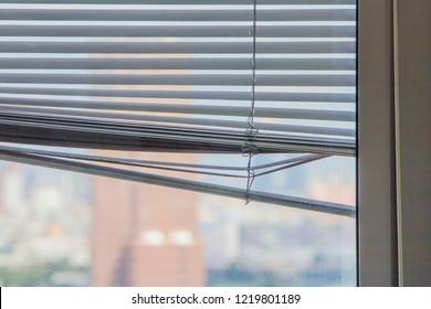 Broken against curtain