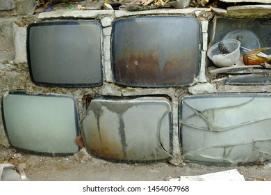 Broken analog television pile. Electronic objects such as television become electronic waste in the world. Electronic waste is a problem in the world because it is difficult to recycle.