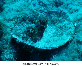 Broken antique clay amphora in deep waters near Hvar - Croatia