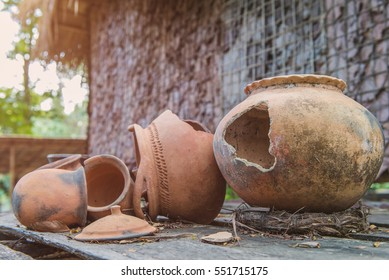 Broken antique clay pot or traditional Jar on abandoned hut.