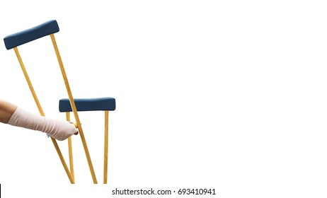 broken arm, closeup woman arm with splint and holding wooden crutches isolated on white, clipping path included.