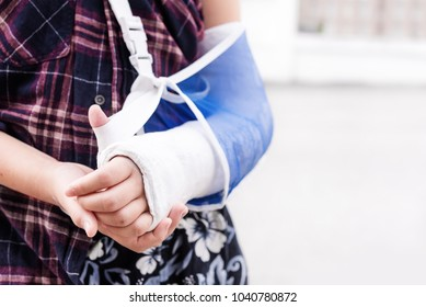 Broken arm of the little boy injured after accident,Arm splint for treatment,injury and health concept