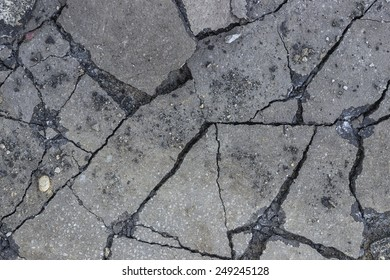 Broken asphalt after working hydraulic hammer background.
