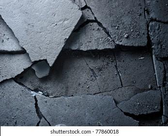 Broken asphalt background texture. Closeup.