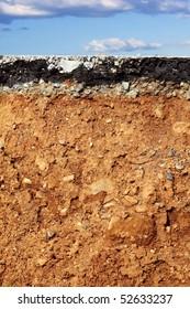 broken asphalt road excavation earthquake cross section blue sky [Photo Illustration]