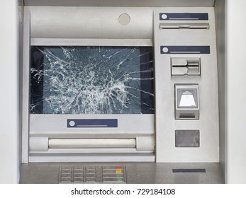 Broken ATM with broken glass. Act of vandalism and hooliganism.