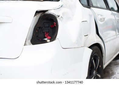 Broken back of the car in white after an accident
