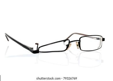 broken black eyeglasses isolated on a white background