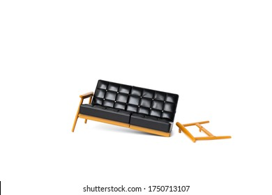 broken black leather sofa with wood leg on white background, broke and fix concept