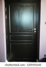 Broken black teak door