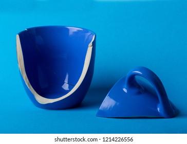 broken blue mug cup background
