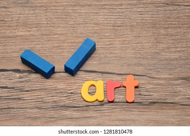 A broken blue pastel with the word art