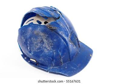A broken blue protective helmet over white