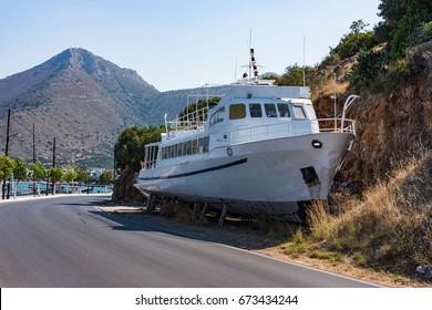 Broken boat at Elounda coast of Crete island in Greece, Lasithi