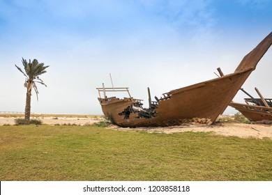 broken boat on beach , Dammam , Saudi Arabia / 12th July 2018