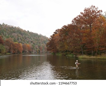 BROKEN BOW, OKLAHOMA—NOVEMBER 2017: A man casts his fishing line at the Mountain Fork River at Beavers Bend State Park, Oklahoma.