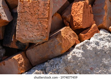 Broken building. Bricks. Destruction of buildings for the construction of new structures