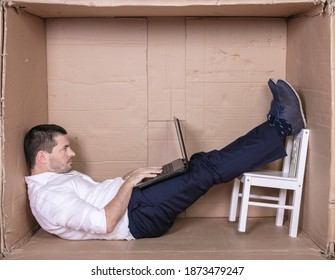 broken businessman in a cardboard office, stress and depression from overwork