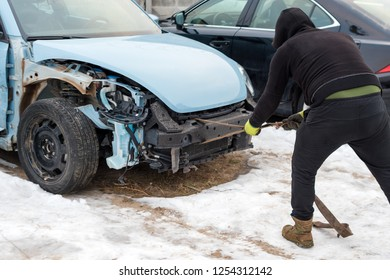 Broken car after an accident. Auto crash, wreck with damage injury. Street, traffic collision. Broken metal. Automobile insurance, safety, repair and transportation. Road dangerous drive.