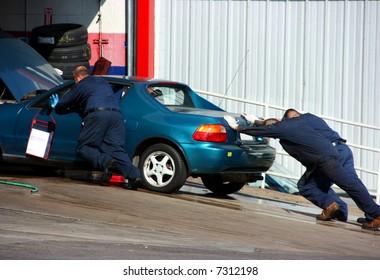 Broken car in autoshop
