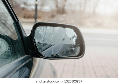 Broken car mirror. The car mirror is damaged, broken glass. Concept of accident, road collision. Damage to the side mirror, bad driving, problems with the car.