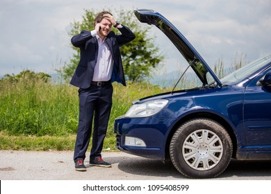 A broken car on the road, a man talks to a cell phone and calls for help on the road
