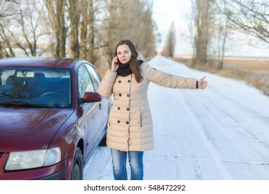 Broken car on winter road