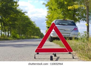Broken car sign on a road