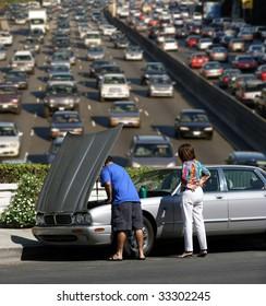 Broken car and traffic jam