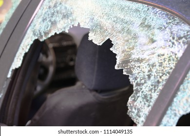 Broken car window and cracked glass of a automobile. Empty copy space for Editor's text.
