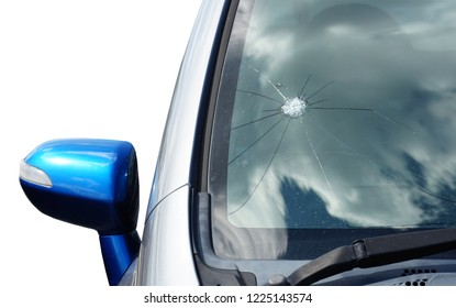 Broken car windshield. Stones on a dirty road from under the wheels at a speed smash car glass. Criminal incidents. Vandals, hooligans mutilated the car, smashed the windshield
