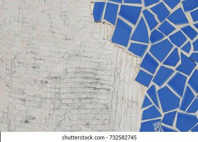 Broken ceramic floor tiles and concrete background.