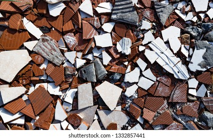 broken ceramic tiles and concrete background