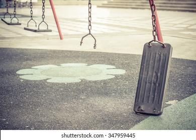 Broken chain swing in playground